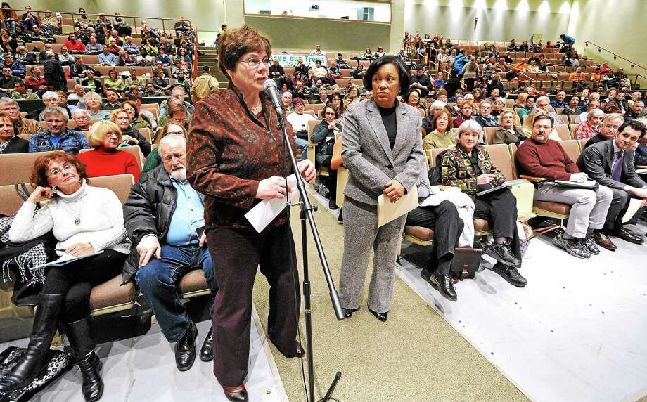 New Haven's Tree Warden and Deputy Director of Parks and Squares Christy Hass, left, and New Haven Mayor Toni Harp were the first to speak at a public hearing Thursday in Hamden regarding United Illuminating's tree-trimming plan. Photo: Mara Lavitt — New Haven Register     / Mara Lavitt