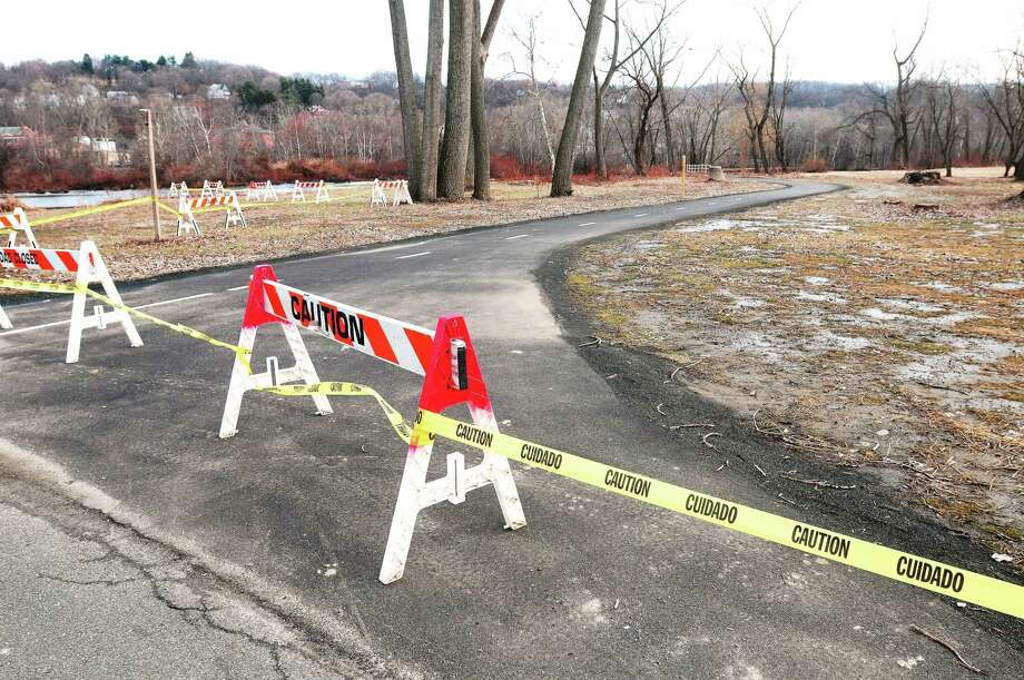 Caution tape prevents pedestrians from entering O'Sullivan Island Recreation Park in Derby photographed on Sunday. Photo: (Arnold Gold - New Haven Register)