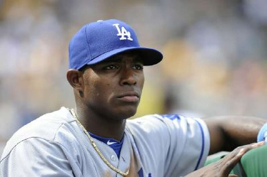 Yasiel Puig watches from the dugout in a June 16, 2013 game.
