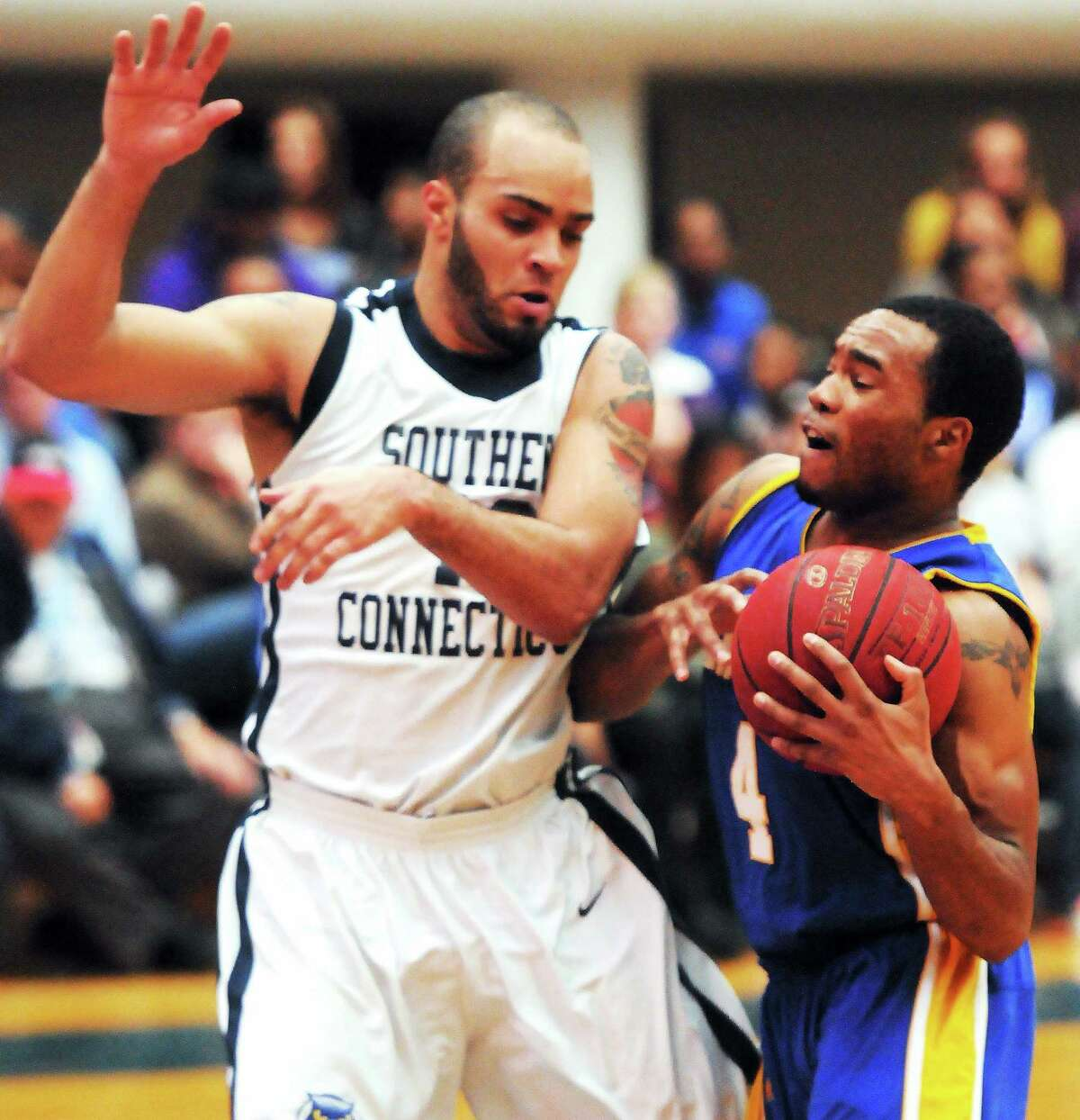 Jeffery Adkins, right, and the University of New Haven fill face Tylon Smith and Southern Connecticut State for the Northeast-10 Conference tournament championship on Saturday afternoon at 1 p.m. at Moore Field House.