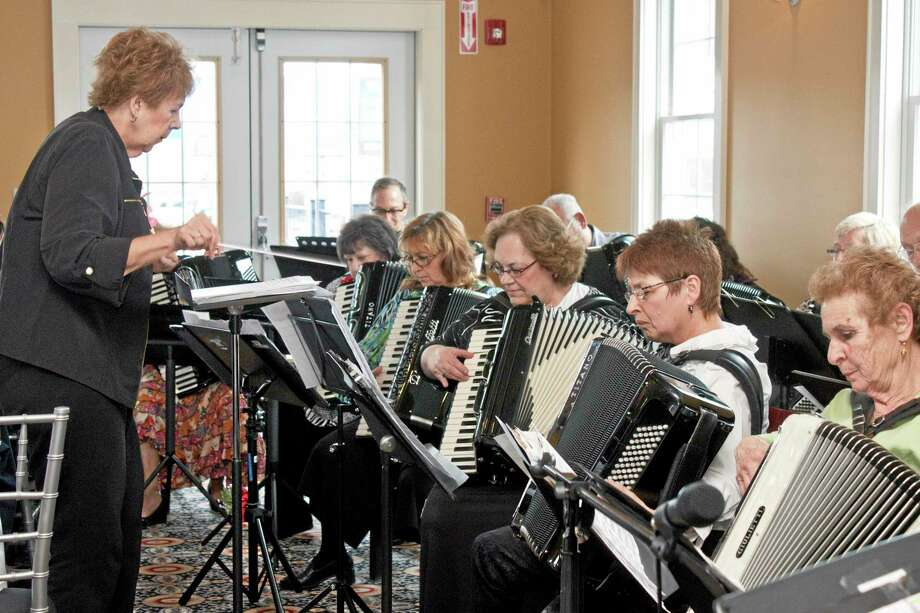 In this April 28, 2014 photo, the Connecticut Accordion Association performs its annual Concert for Youth at Vasi's Restaurant & Bar in Waterbury, Conn. (AP Photo/Republican-American, Darlene Douty) Photo: AP / Republican-American