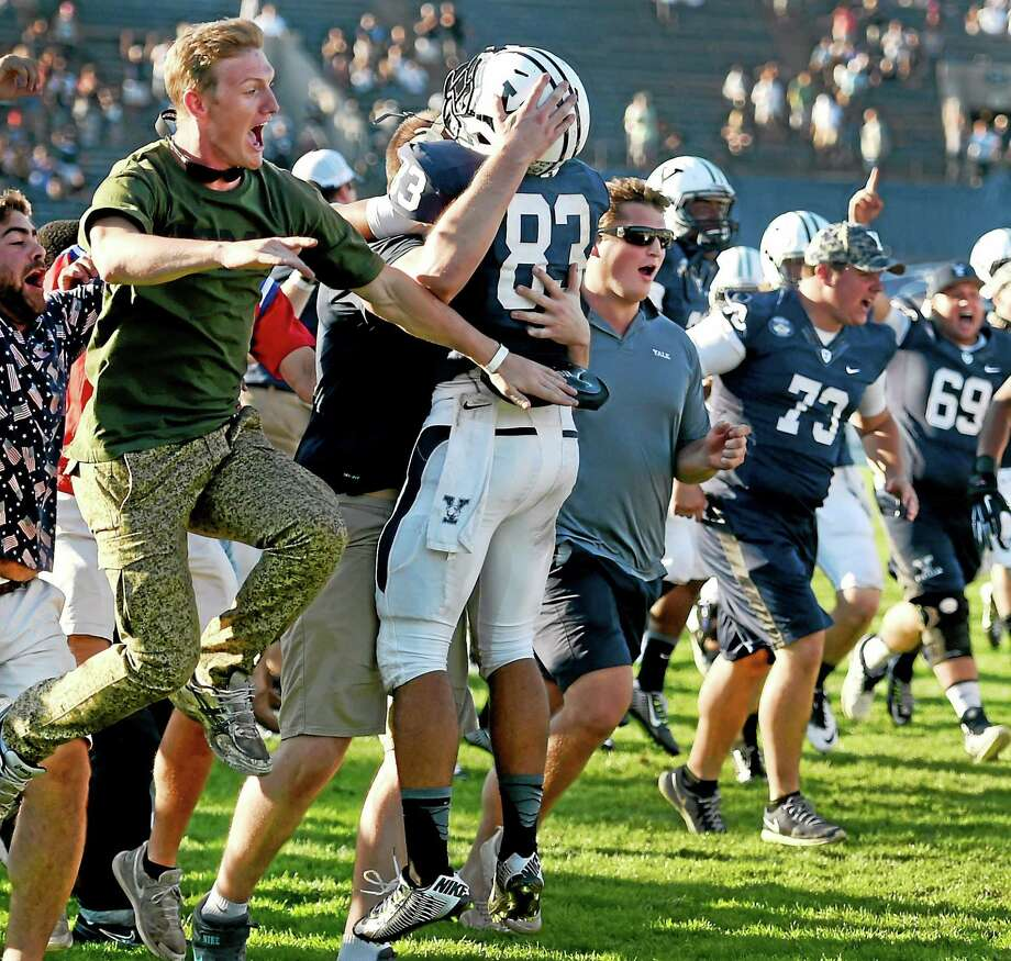 Yale fans rush the field after Yale running back Taylor Varga scored a touchdown in overtime to defeat  Army 49-43 at Yale Bowl. Photo: Peter Hvizdak — Register File Photo   / ©2014 Peter Hvizdak