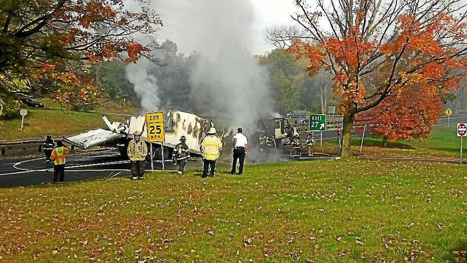 A tractor-trailer hauling butter caught fire Tuesday morning after crashing into an overpass on Route 15 near the Connecticut-New York border in Greenwich, police said. No one was injured. Photo: Contributed Photo — Greenwich Police Department