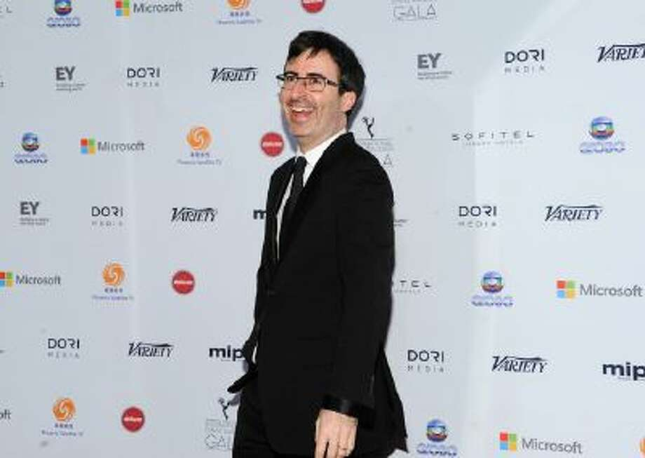 In this Nov. 25, 2013 photo, John Oliver arrives at the 2013 International Emmy Awards Gala at the New York Hilton, in New York.
