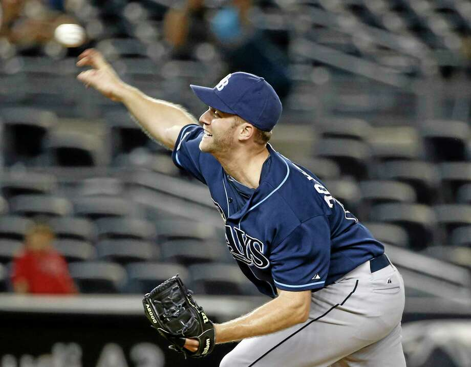 Tampa Bay Rays relief pitcher Brad Boxberger delivers in the 12th inning of the Rays' 4-3 victory over the New York Yankees on Monday. Photo: Kathy Willens — The Associated Press   / AP