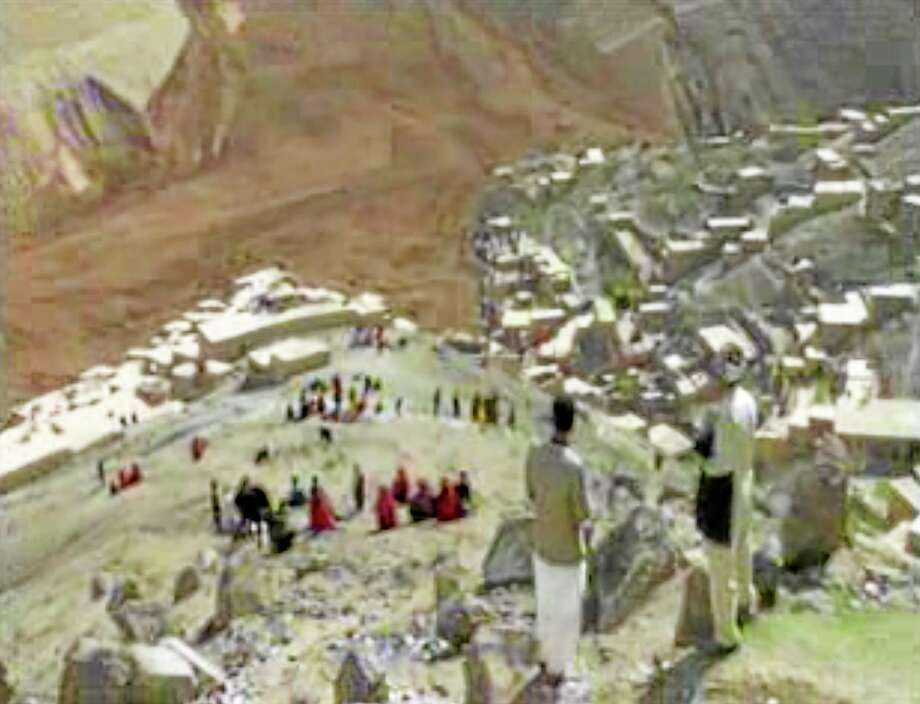 This image made from AP video shows people searching for survivors after a massive landslide landslide buried a village Friday, May 2, 2014 in Badakhshan province, northeastern Afghanistan, which Afghan and U.N. officials say left hundreds of dead and missing missing. (AP Photo via AP video) Photo: AP / AP video
