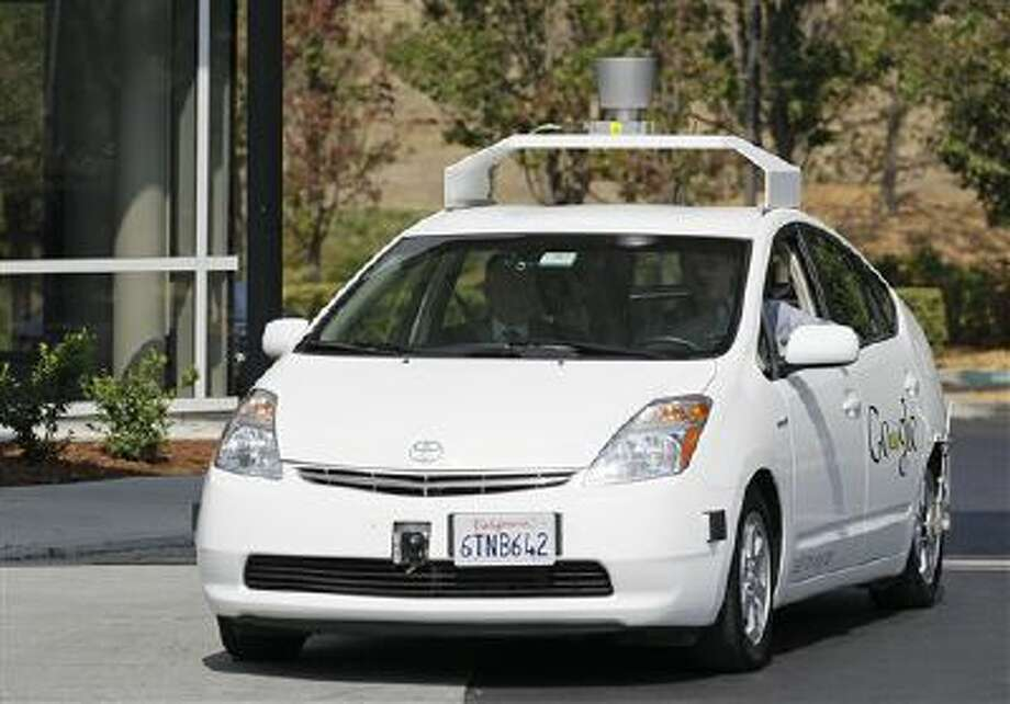 In this Sept. 25, 2012, file photo, California Gov. Edmund G Brown Jr., front left, rides in a driverless car to a ceremony in Mountain View, Calif., for the signing of a bill allowing for testing of driverless vehicles in the state. Photo: AP / AP