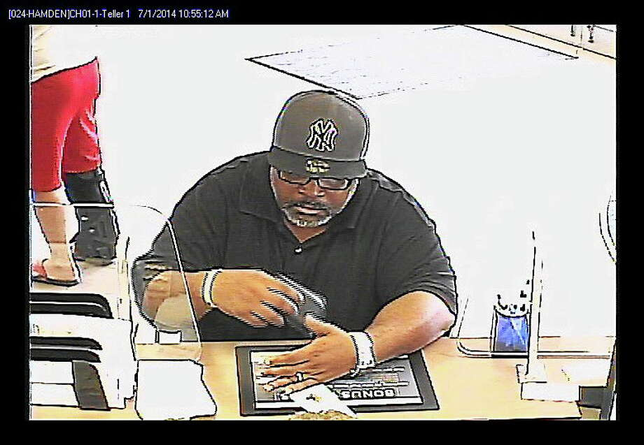 A surveillance photo shows a man police say robbed the Webster Bank branch, 5 Helen St., on Tuesday. An alleged accomplice was arrested. Photo: Contributed Photo — Hamden Police