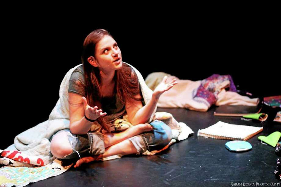"SCSU photo  Ashley Malloy in ""My Name is Rachel Corrie."" Photo: Journal Register Co."
