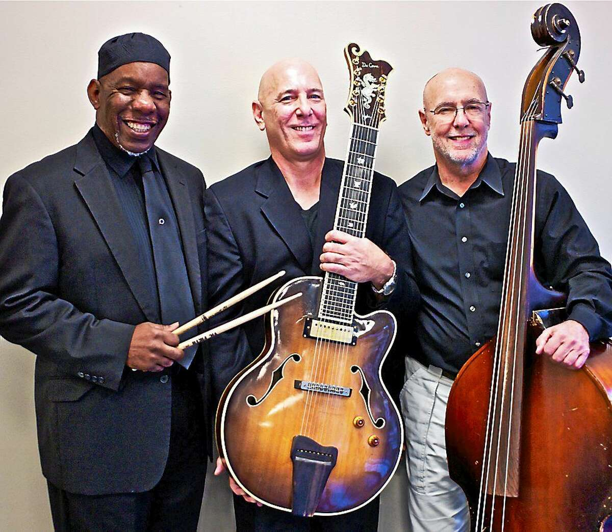 """NMS Jesse Hameen II (drums), left, Michael Coppola (guitar) and Jeff Fuller (bass) will perform in the Neighborhood Music School's Faculty Concert """"The Art of the Guitar Trio"""" at 12:10 p.m. Friday."""