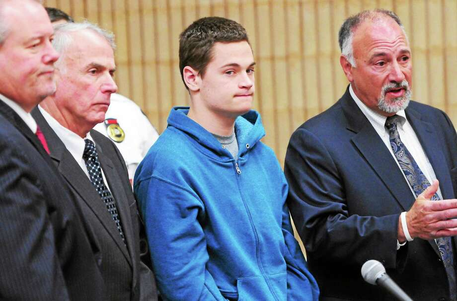 Christopher Michael Plaskon, 16, of Milford,  in his first public court appearance Friday, May 2, 2014 at State Superior Court in Milford, Connecticut, for the stabbing murder of Jonathan Law High School classmate Maren Sanchez,  stands with his defense attorneys Edward Gavin, far left, and  Richard T. Meehan Jr. far right, and Paul Healy, second from left, who was is Plaskon's Uncle and court-appointed guardian. Photo: (Peter Hvizdak - New Haven Register)   / ©Peter Hvizdak /  New Haven Register