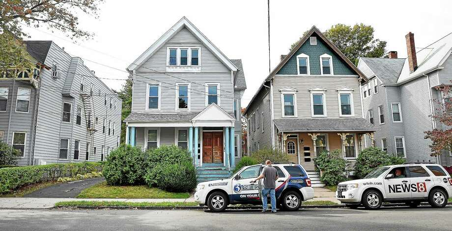 (Arnold Gold-New Haven Register)  Television crews park outside of a home where a Yale University student is quarantined at his home on Edwards St. in New Haven on 10/28/2014. Photo: Journal Register Co.