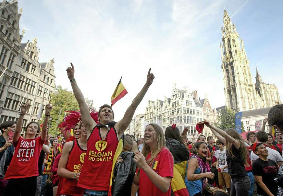 Belgian fans cheer after Belgium scored a goal as they watch the soccer match on a giant screen in the Grote Markt in Antwerp, Belgium on Sunday, June 22, 2014. Belgium scored a 1-0 victory over Russia during the group H World Cup soccer match between Belgium and Russia at the Maracana Stadium in Rio de Janeiro, Brazil. (AP Photo/Virginia Mayo) Photo: AP / AP