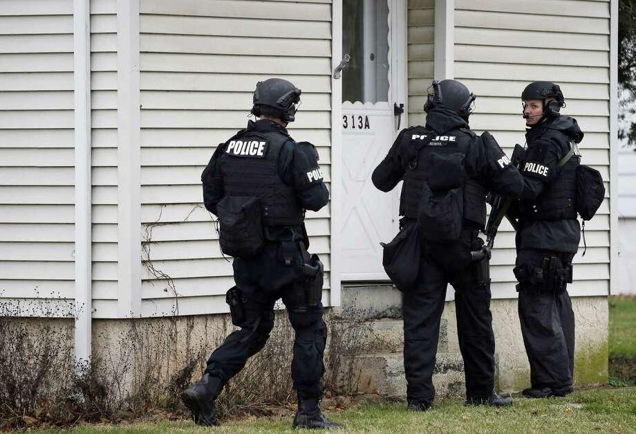 Police search for suspect Bradley William Stone on Dec. 16, 2014 in Pennsburg, Pa. Photo: AP Photo/Matt Rourke   / AP