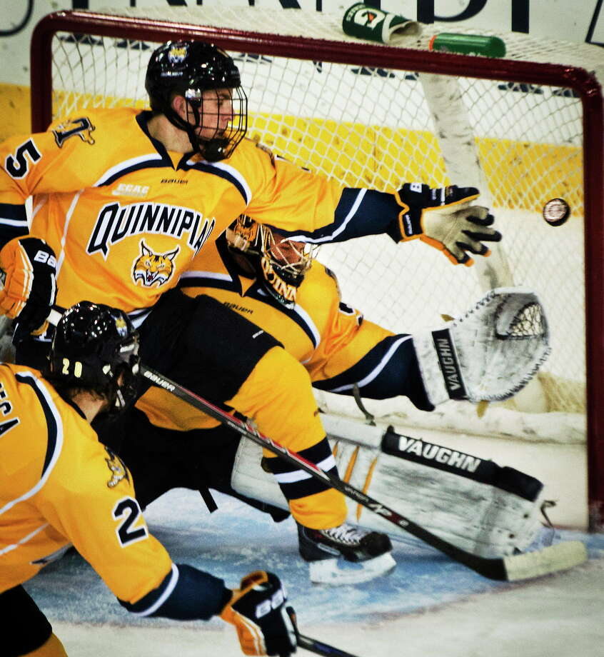 Quinnipiac's Matthew Peca, Devon Toews and goalie Michael Garteig can't stop a short-handed gaol by Maine's Devin Shore during a Jan. 3 game in Hamden. The seventh-ranked Bobcats take on No. 4 Union on Friday night. Photo: Melanie Stengel — Register