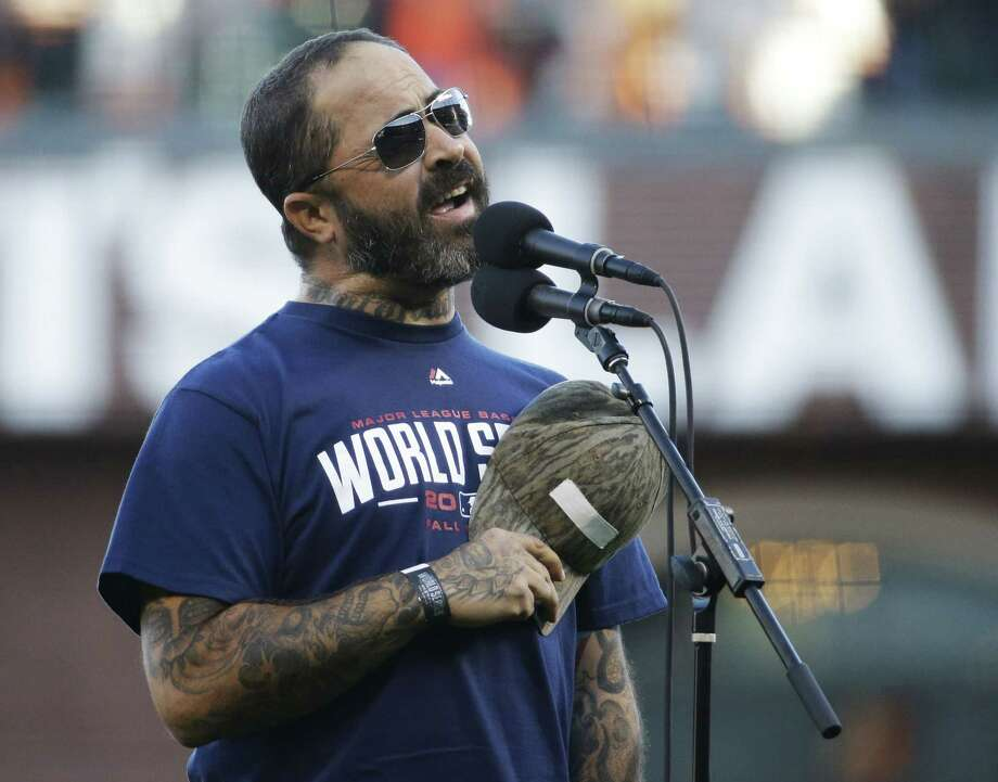 Recording artist Aaron Lewis performs the national anthem before Game 5 of the World Series on Sunday. Photo: Matt Slocum — The Associated Press   / AP