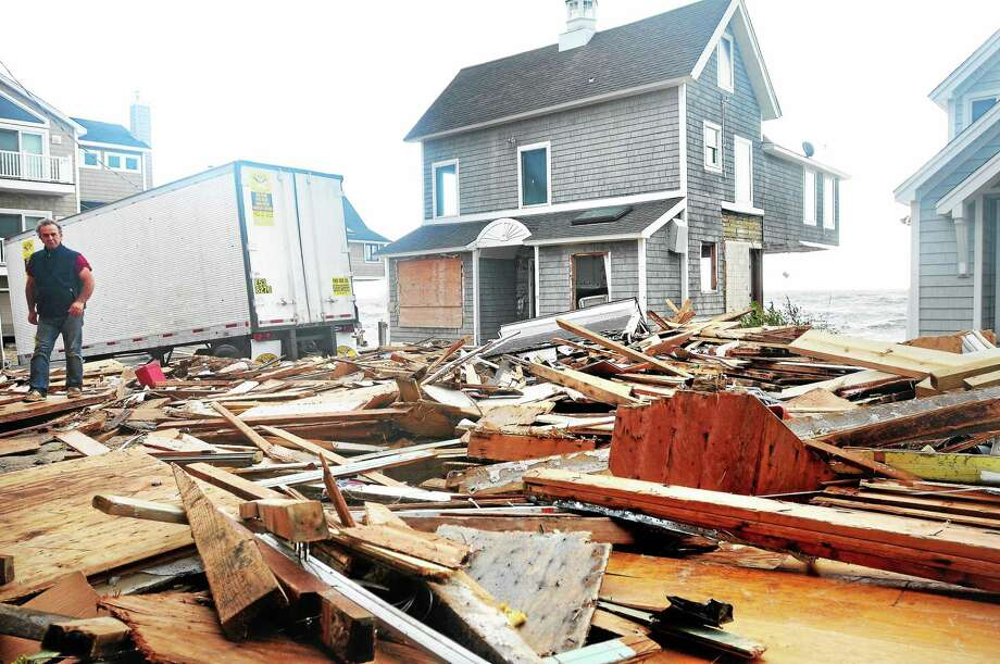 File photo of Sandy damage on Broadway in Milford on 10/30/2012. Photo: Photo By Arnold Gold/New Haven Register