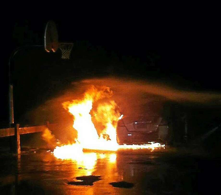 Police are investigating after a stolen sedan was destroyed in suspicious fire Monday night at Linnett Park. Photo: (courtesy Of Ansonia Fire Department)