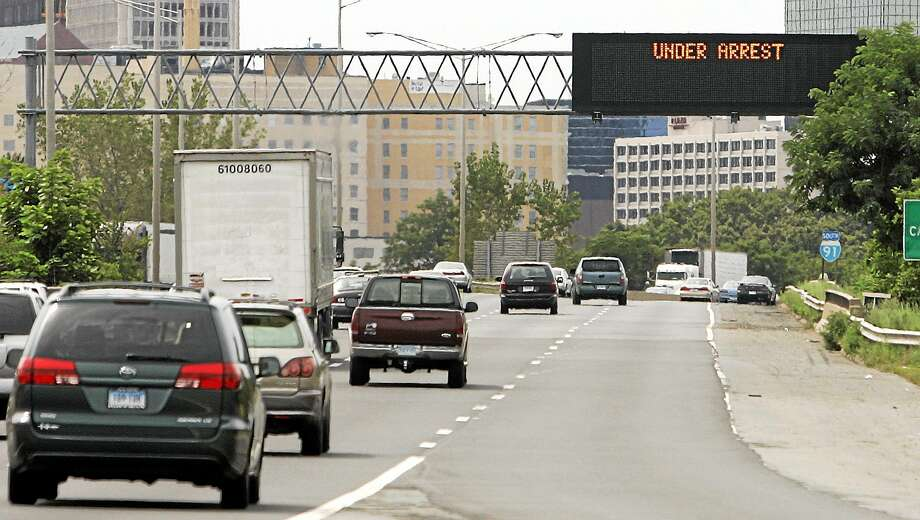An overhead sign on Interstate-91 in Hartford, Conn. Photo: AP Photo/Bob Child   / AP