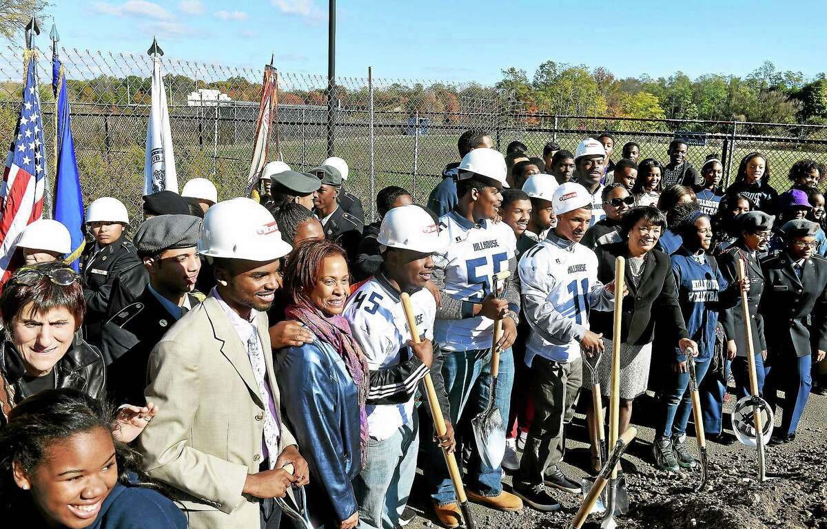 James Hillhouse High School students and public officials pose for photographs at a ground-breaking ceremony for Bowen Field in New Haven Monday.