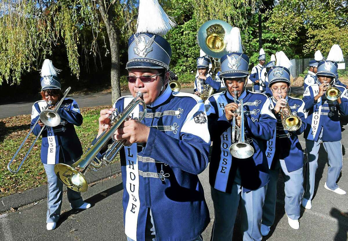 The James Hillhouse High School Marching Band performs at a ground-breaking ceremony for Bowen Field Monday.