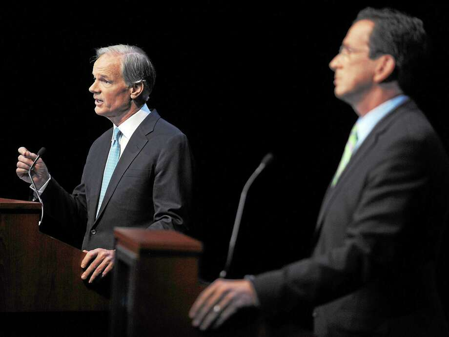 In a file photo, Republican Tom Foley, left, faces Democrat Dannel Malloy in a gubernatorial debate held at the Garde Arts Center in New London in 2010. A rematch of that race may be in the works, according to a recent Quinnipiac Poll. Photo: Tim Martin — New London Day — The Associated Press   / 2010 The Day Publishing Company