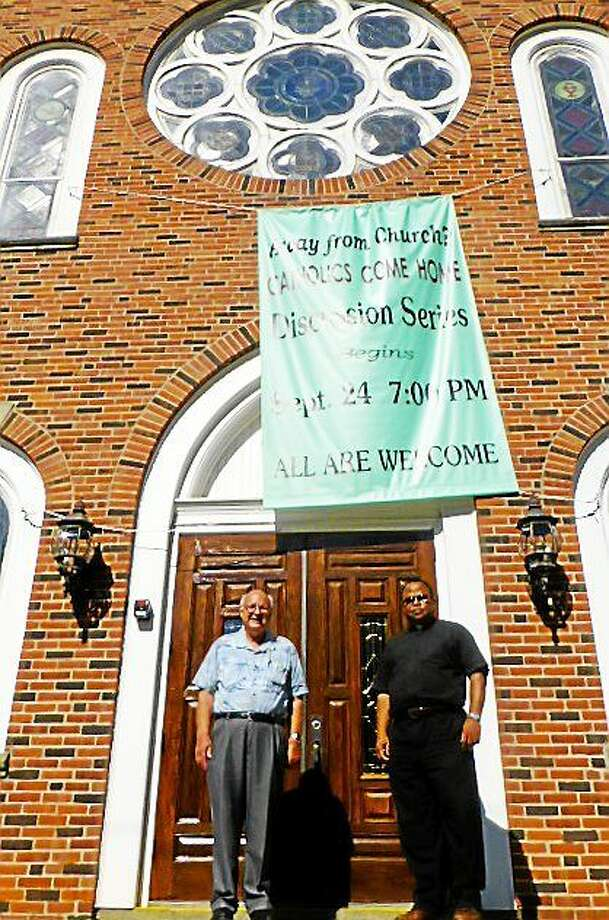 Seymour resident Bill Wilkin, left, and the Rev. Honore Kombo stand outside St. Augustine's Church in Seymour. Patricia Villers/Register Photo: Journal Register Co.