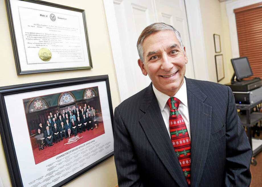 Newly elected State Senate Minority Leader Len Fasano is photograph in his office in New Haven on 12/23/2014. He is standing next to a photo of the State Senate from 2003 when he first served. Photo: (Arnold Gold-New Haven Register)