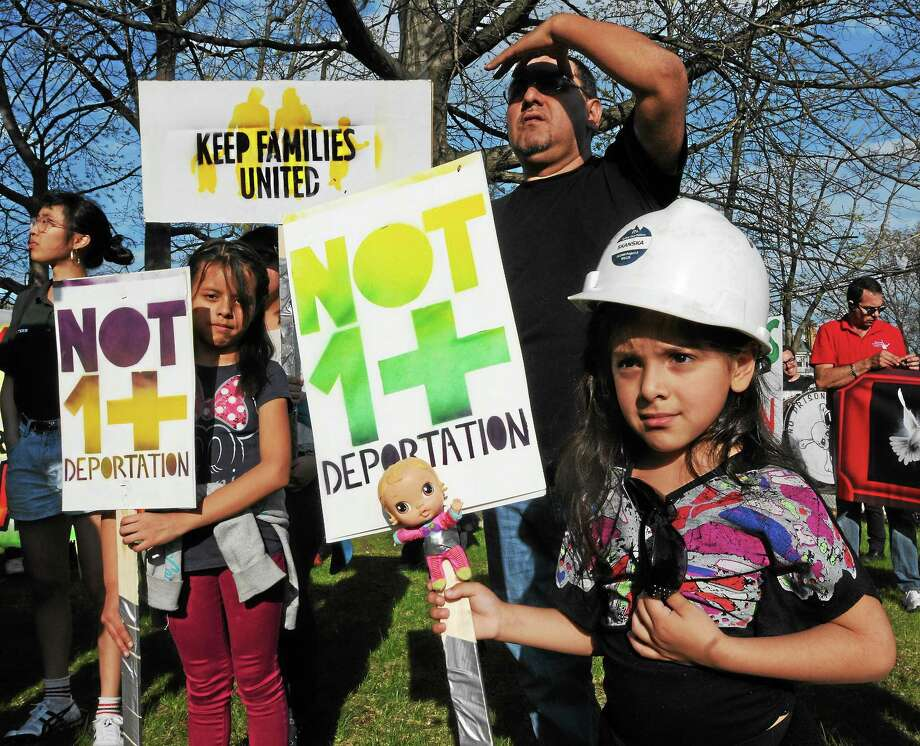 Immigrant workers and their supporters, including, from left, Catherine Mendez, 9, Eduardo Jara and his daughter, Brianna, 6, all of Meriden, march through Fair Haven Thursday to call attention to deportations and immigration issues. Photo: Mara Lavitt — New Haven Register     / Mara Lavitt