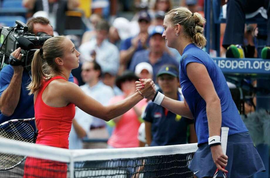 Aleksandra Krunic, left, greets Petra Kvitova after winning their third round match on Saturday. Photo: Kathy Willens — The Associated Press   / AP
