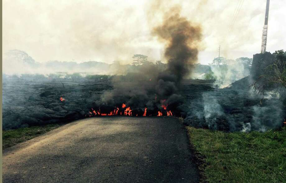 In this Oct. 24, 2014 photo from the U.S. Geological Survey, the lava flow from Kilauea Volcano that began June 27 is seen near the town of Pahoa on the Big Island of Hawaii. Authorities on Saturday told several dozen residents near the active lava flow to prepare for a possible evacuation in the next three to five days as molten rock oozed across the country road and edged closer to homes. Photo: AP Photo/U.S. Geological Survey   / U.S.Geological Survey