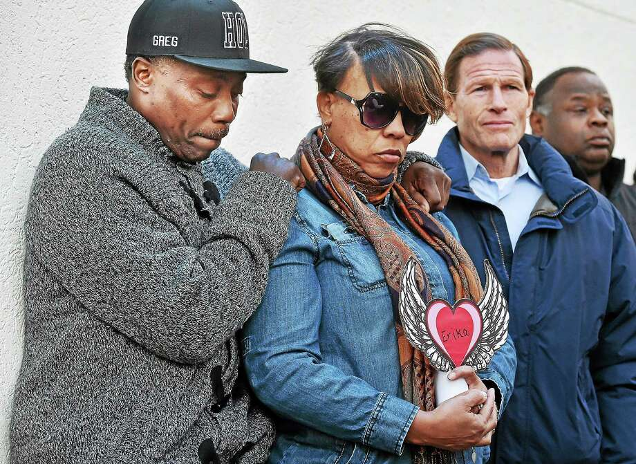 Celeste and Greg Fulcher, held a vigil Sunday in memory of their daughter Erika Robinson at the former Key Club Cabaret in New Haven. Robinson, 26, of West Haven, was shot and killed one year ago inside the club. Photo: Catherine Avalone - New Haven Register   / New Haven RegisterThe Middletown Press