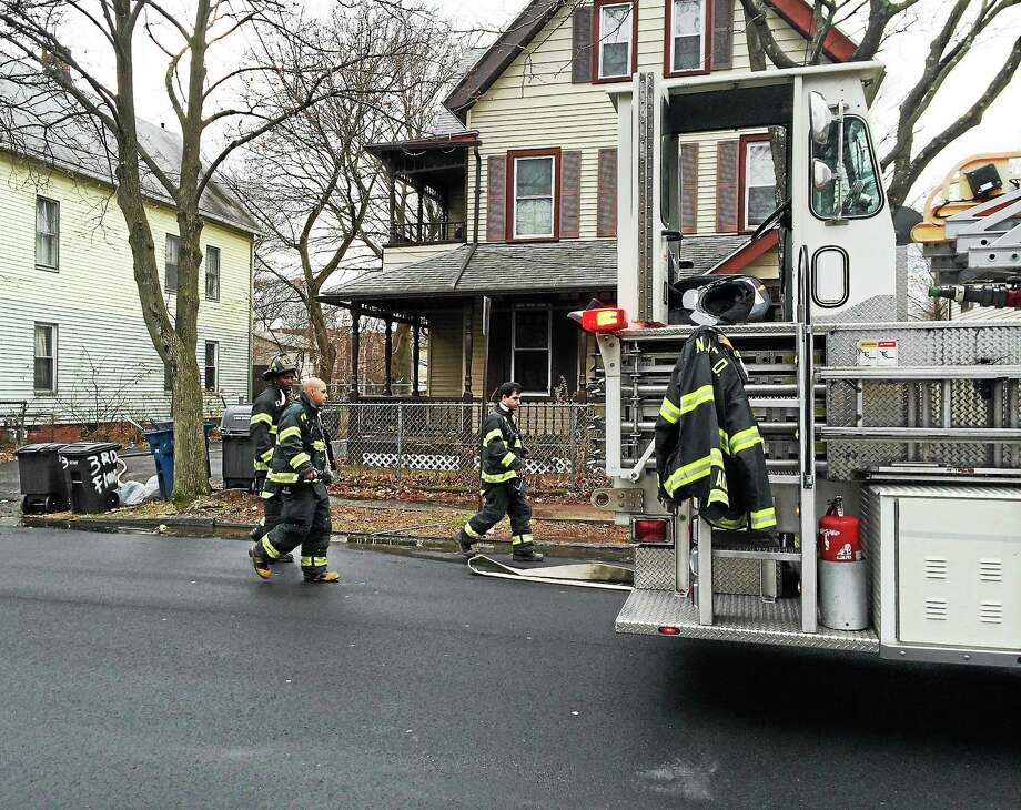 A basement fire damaged a home on Ivy Street in New Haven on Monday. One person inside was able to get out safely. Photo: (Wes Duplantier -- New Haven Register)