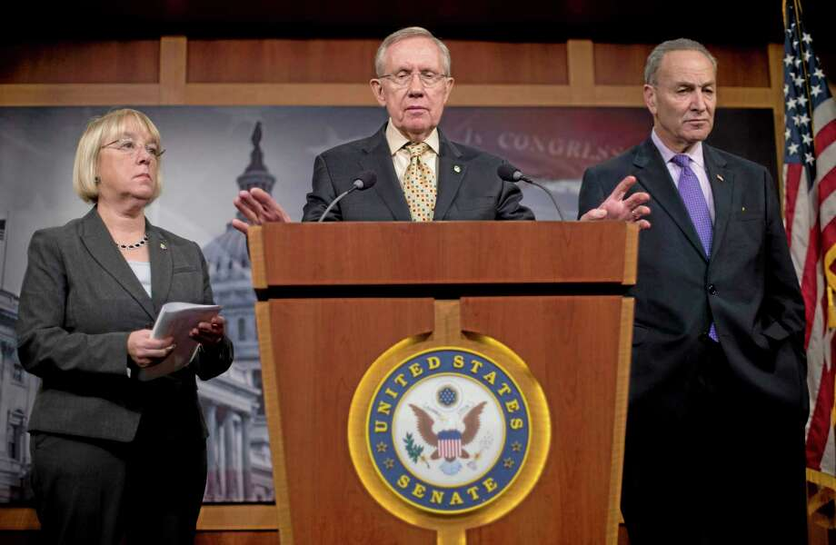 Senate Majority Leader Harry Reid of Nevada, center, accompanied by Sen. Patty Murray, D-Wash., left, and Sen. Charles Schumer, D-N.Y., gestures during a news conference about extending unemployment insurance benefits Thursday on Capitol Hill in Washington, D.C. Photo: Pablo Martinez Monsivais — The Associated Press   / AP