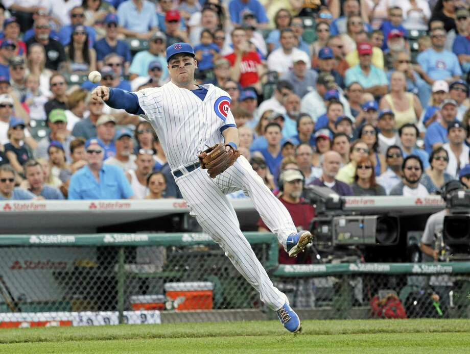 Cubs third baseman Mike Olt throws out Pittsburgh Pirates' Russell Martin after the Branford native fielded Martin's sacrifice bunt in a June 20 game. Photo: Charles Rex Arbogast  — The Associated Press   / AP
