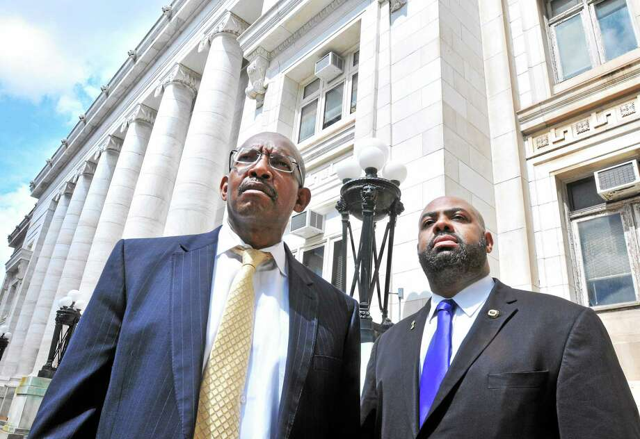 Attorneys Bevin Salmon, left, and Michael Jefferson are photographed outside of Superior Court in New Haven on 6/26/2014. Photo: (Arnold Gold — New Haven Register)