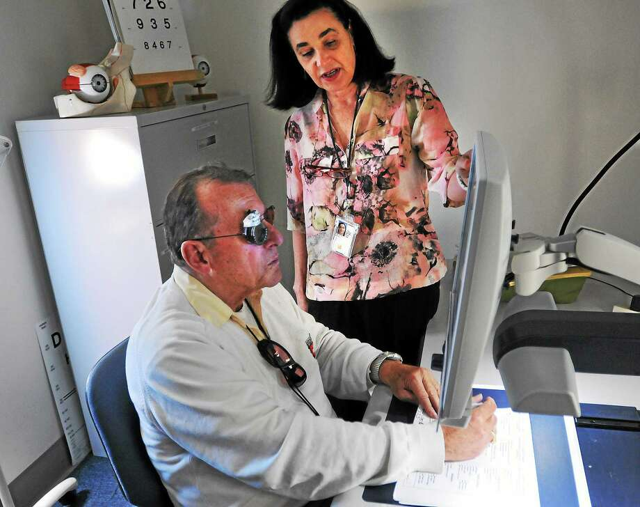 Robert Campanile, 78, of an Army Korean War veteran works with vision rehab Specialist Olivia D'Angelos at the Eastern Blind Rehabilitation Center last week. Photo: (Peter Casolino-New Haven Register)