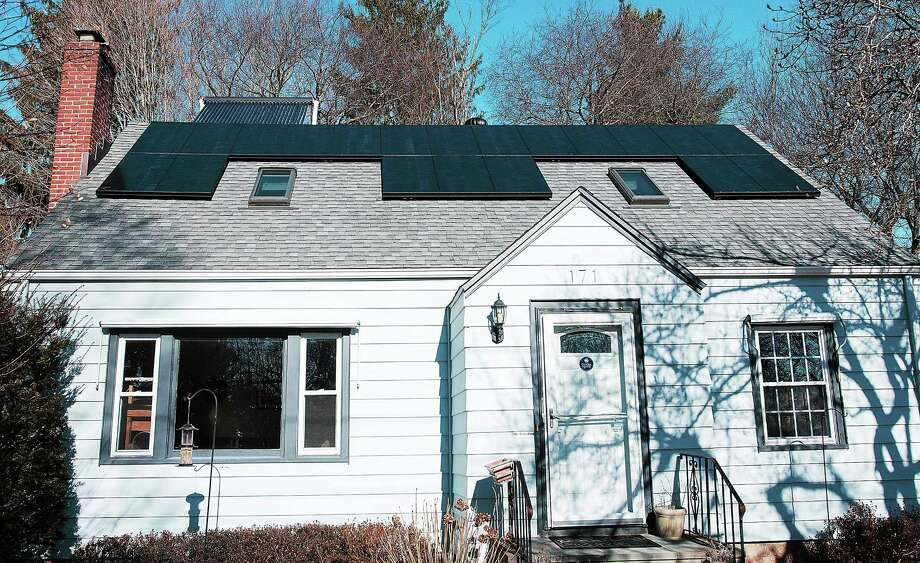 A home in Hamden owned by Chris Marchand, the town community development manager, is fitted with solar panels. Photo: Peter Casolino — New Haven Register