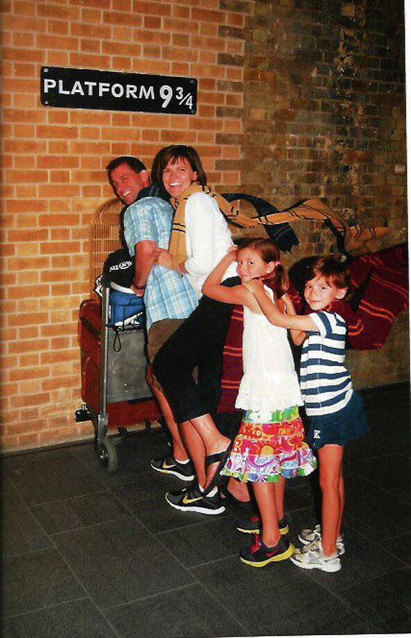 """From front to back: Doug, Kim, Emalena and Sierra Preveza pretend to enter  the infamous 9 3/4 platform depicted in the """"Harry Potter"""" book series. Contributed photo Photo: Journal Register Co."""