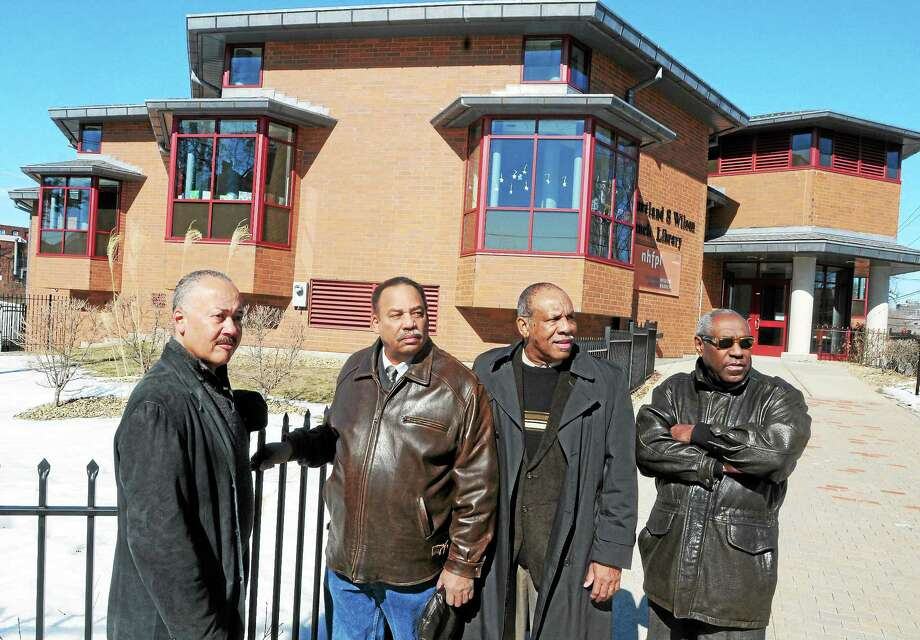 From left, Jon Wilson of New Haven, Brack Poitier of Hamden, William Haynes of Woodbridge and Larry M. Stewart of New Haven at the Courtland Seymour Wilson Branch Library on Washington Avenue in New Haven. Photo: Peter Hvizdak — New Haven Register   / ©Peter Hvizdak /  New Haven Register