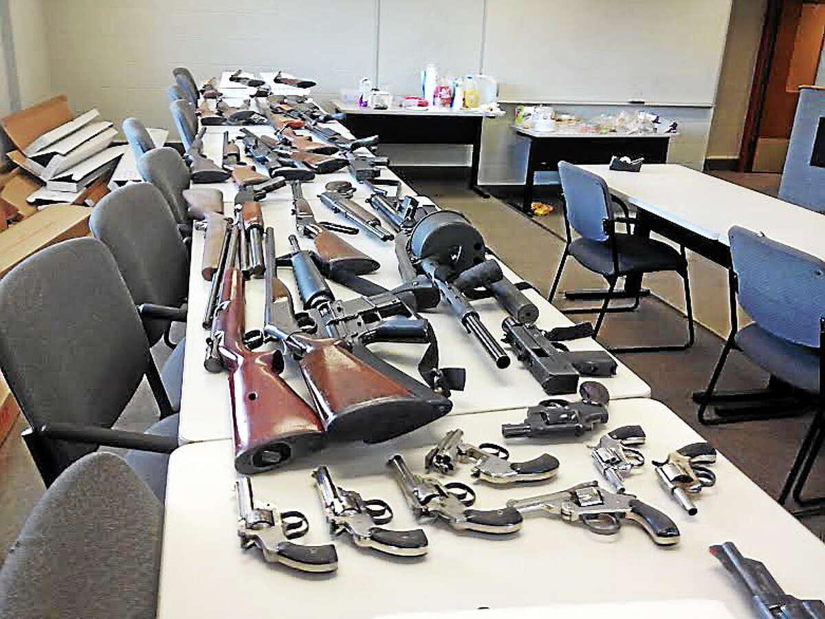 More than 50 guns were turned in during New Haven's gun buyback program Saturday, June 28. Register photo - Kristin Stoller