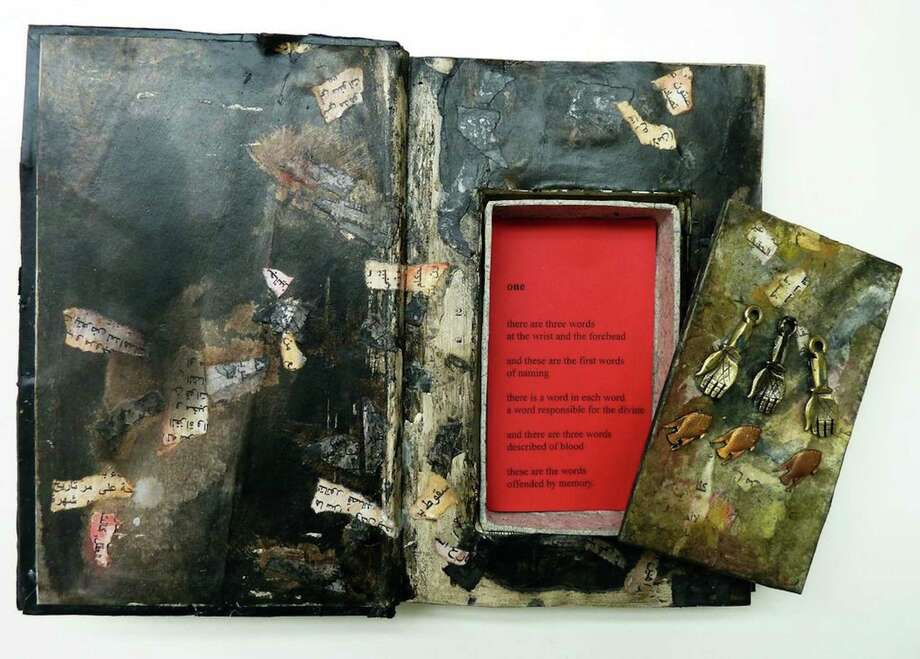 """Beau Beausoleil and Andrea Hassiba's """"Until It Is in Flame,"""" 2012, a mixed media, paint, papier-mâché, bronze Milagros, schoolbook strap and paper. Photo: Contributed Photo"""