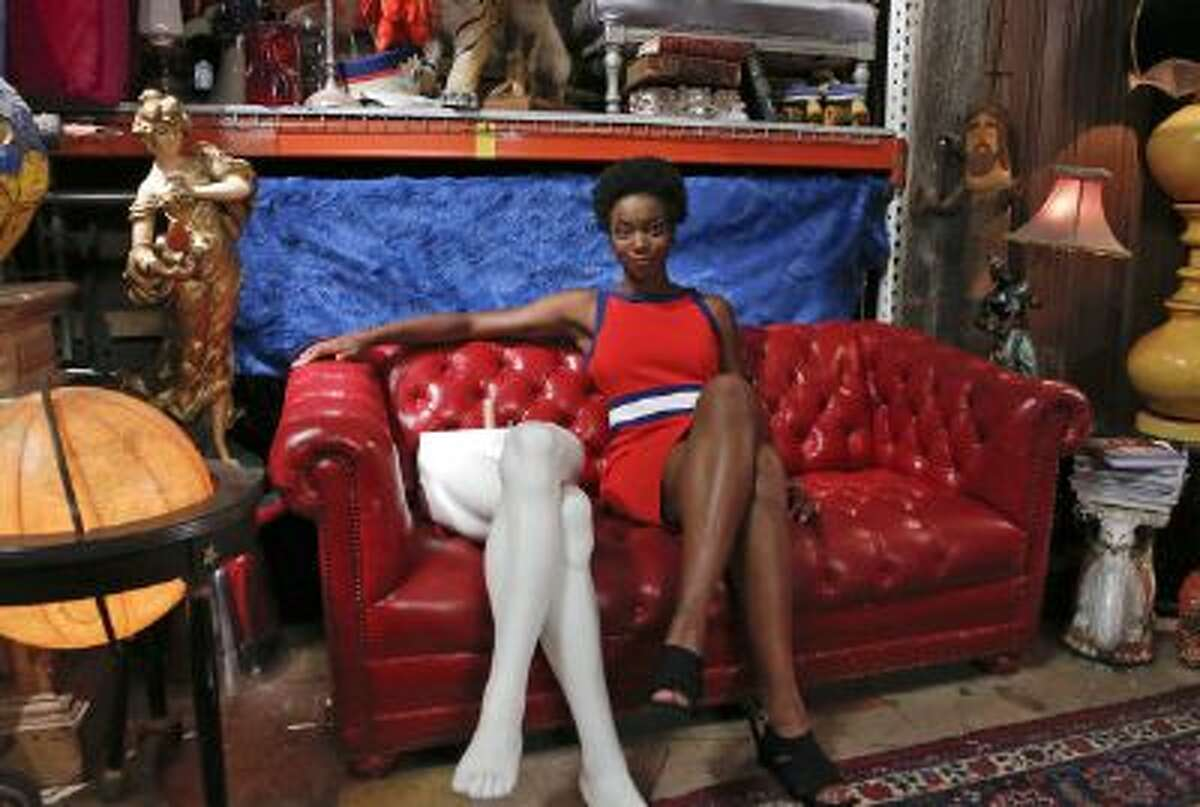 """Sasheer Zamata poses for a photograph for an ABC series, """"Would You Fall For That?"""" in 2013. The black comedian will be joining the cast of """"Saturday Night Live,"""" NBC has announced."""