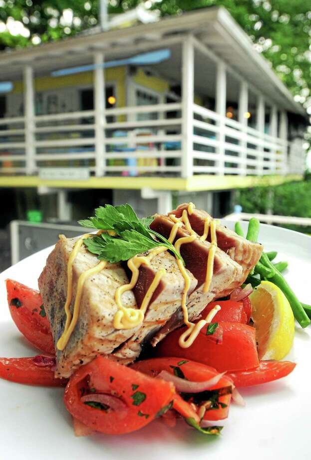 Seared rare tuna with tomato, cucumber and onion salad. Photo: Journal Register Co.