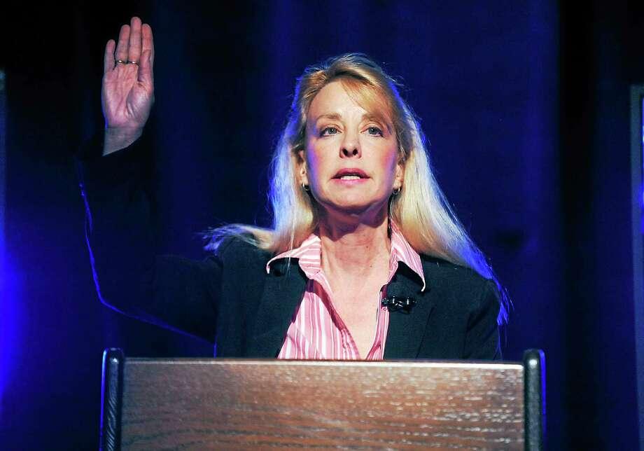 Lee Whitnum gestures during a U.S. Senate candidate debate in Storrs, Conn. on April 9, 2012. Photo: AP Photo/The Hartford Courant, John Woike, Pool   / AP2012