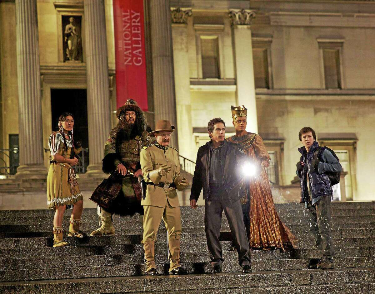 """Mizuo Peck, left, Patrick Gallagher, the late Robin Williams, Ben Stiller, Rami Malek and Skyler Gisondo in """"Night at the Museum: Secret of the Tomb."""""""