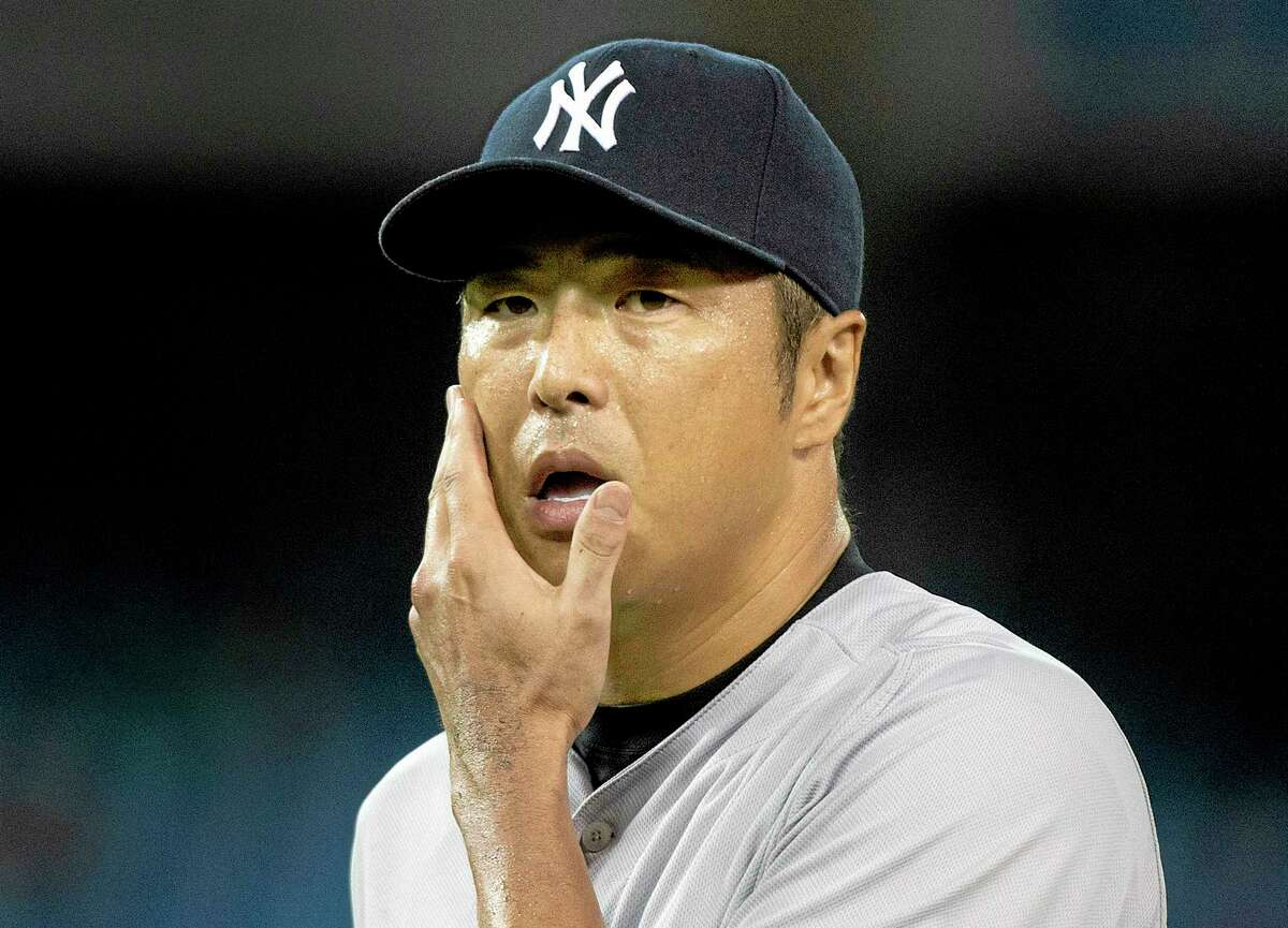 Yankees staring pitcher Hiroki Kuroda walks back to the dugout during the seventh inning against the Toronto Blue Jays on Wednesday.