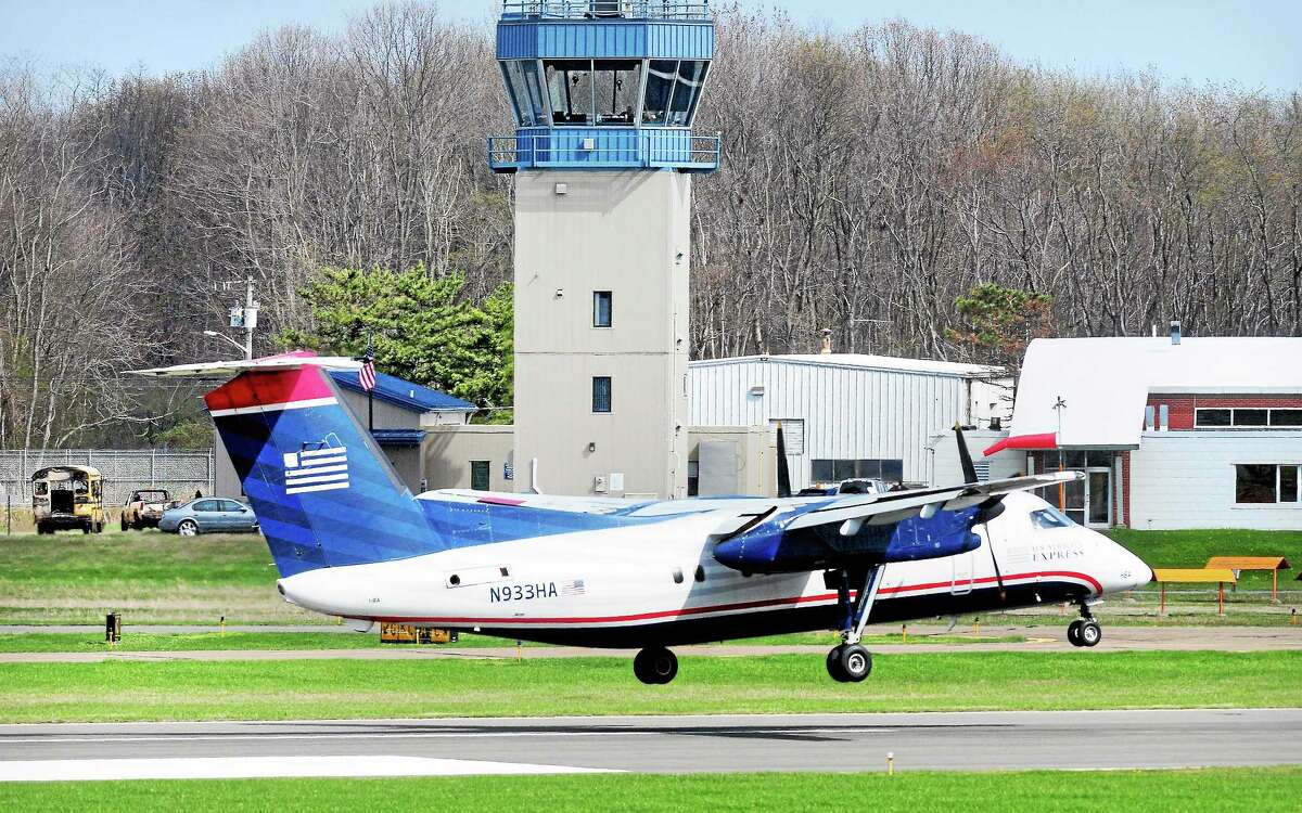 A US Airways flight lands at Tweed New Haven Regional Airport.