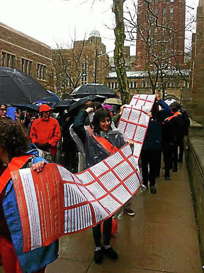 Yale graduate students march down Wall Street in New Haven with a petition asking for a unionization vote. Photo: Jim Shelton — New Haven Register