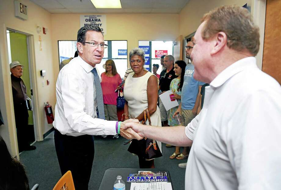 Governor Dannel Malloy (left) shakes hands with Dan McDermott of Shelton during a visit with campaign volunteers at the Connecticut Democratic Party offices in New Haven on 8/17. Photo: (Arnold Gold-New Haven Register)